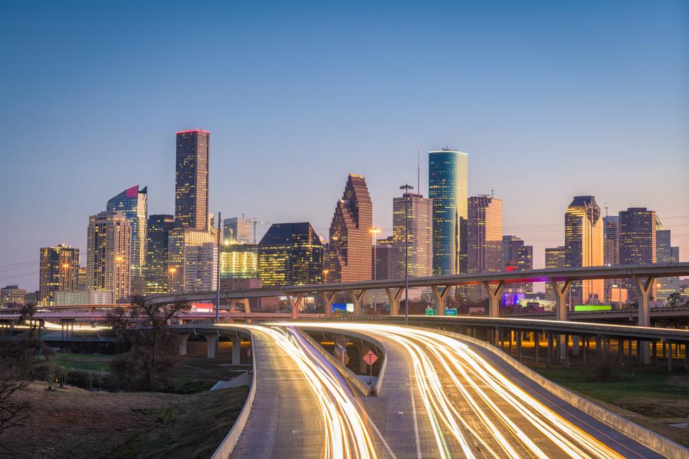 houston skyline at dusk with cars with texas insurance