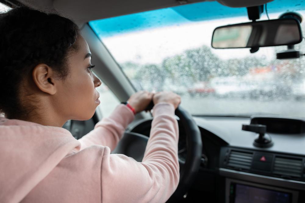 woman driving car in the rain